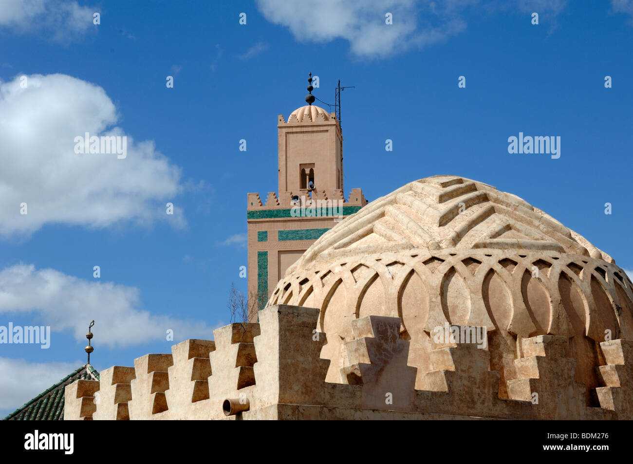 Dome or Cupola of the Koubba Ba'adiyn Almoravid Ablutions Fountain (c12th)& Ali Ben Youssef Minaret & - Stock Image