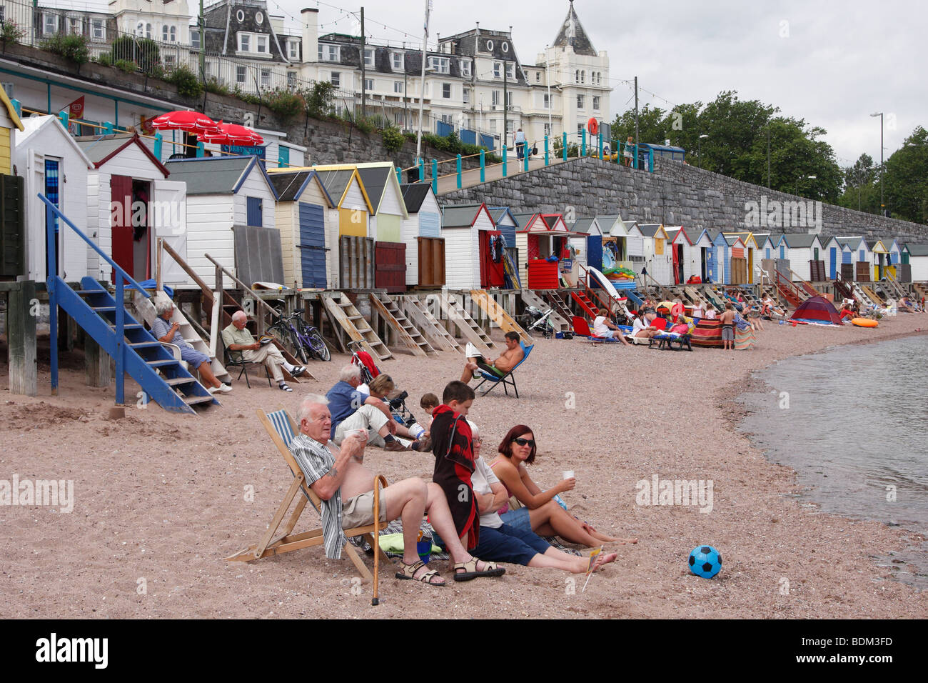 British family on seaside holiday, Torquay beach, Devon, England, UK - Stock Image