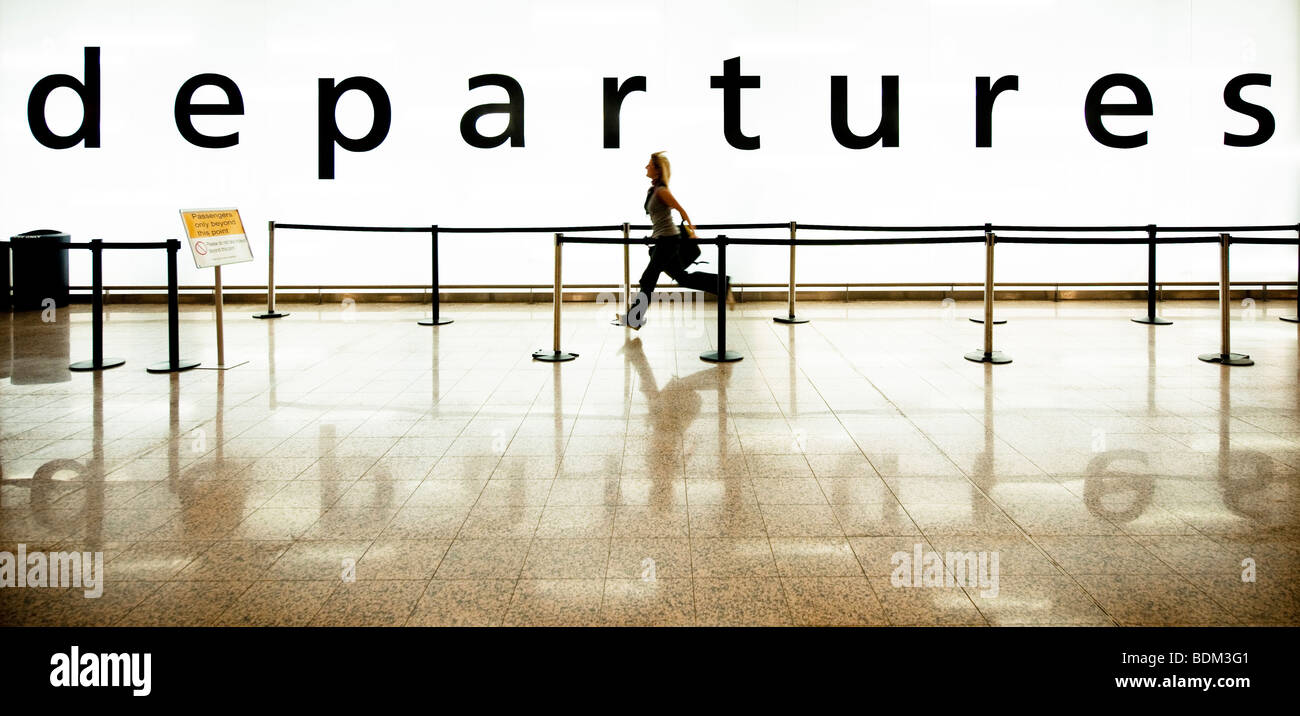 Colour color panoramic image of a girl running to the departure lounge to catch her flight Stock Photo