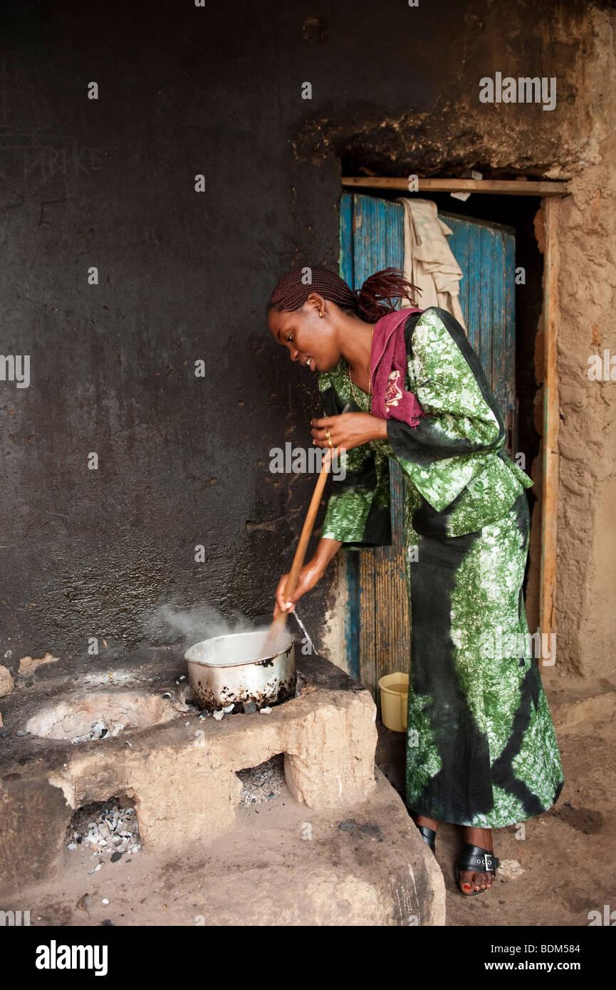 woman preparing food, Kigali, Rwanda - Stock Image