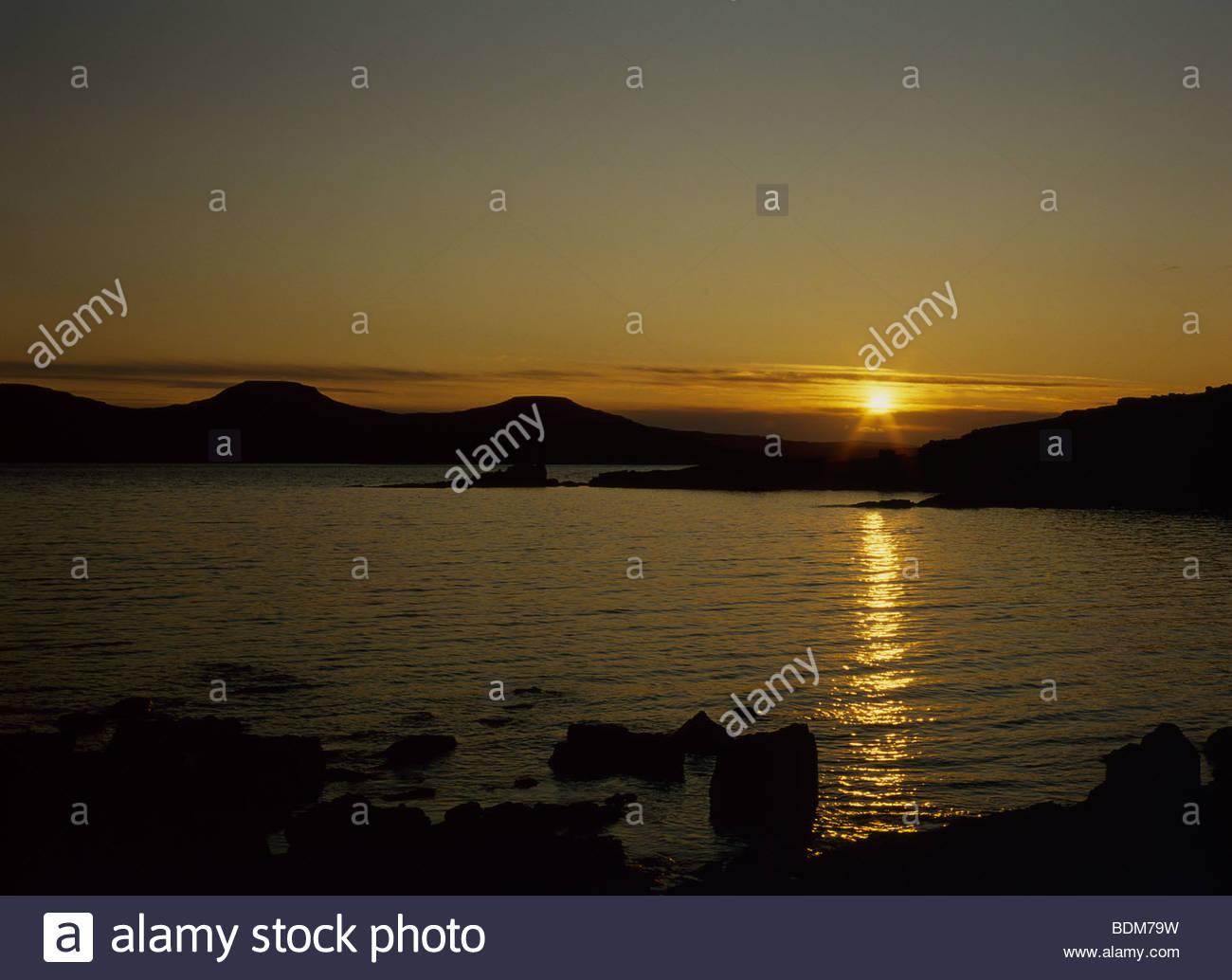 Sunset Ullinish looking towards MacLeod's Tables Skye Scotland Stock Photo