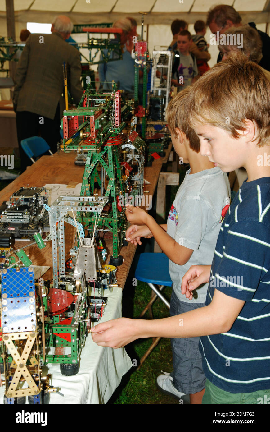 small boys playing with meccano exhibits at a model exhibition, cornwall, uk - Stock Image