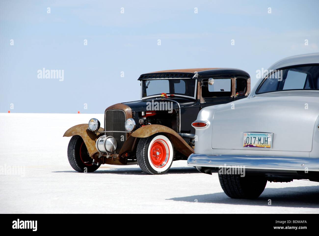 two oldtimers, antique cars, on the Bonneville Salt Flats, Utah - Stock Image