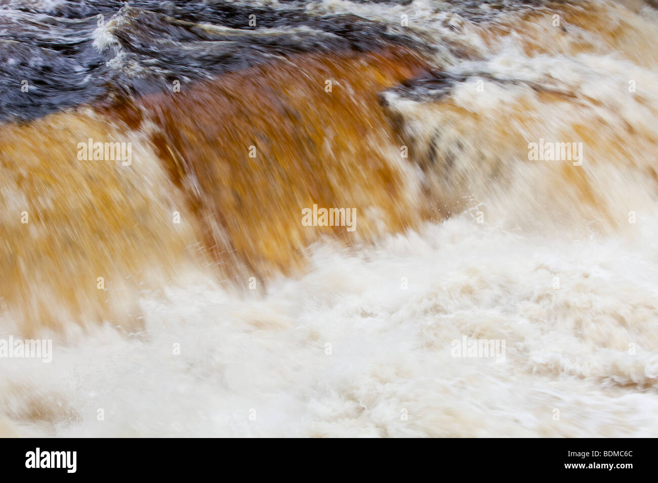Peat staining in the river Clyde at New Lanark, Scotland, UK. - Stock Image