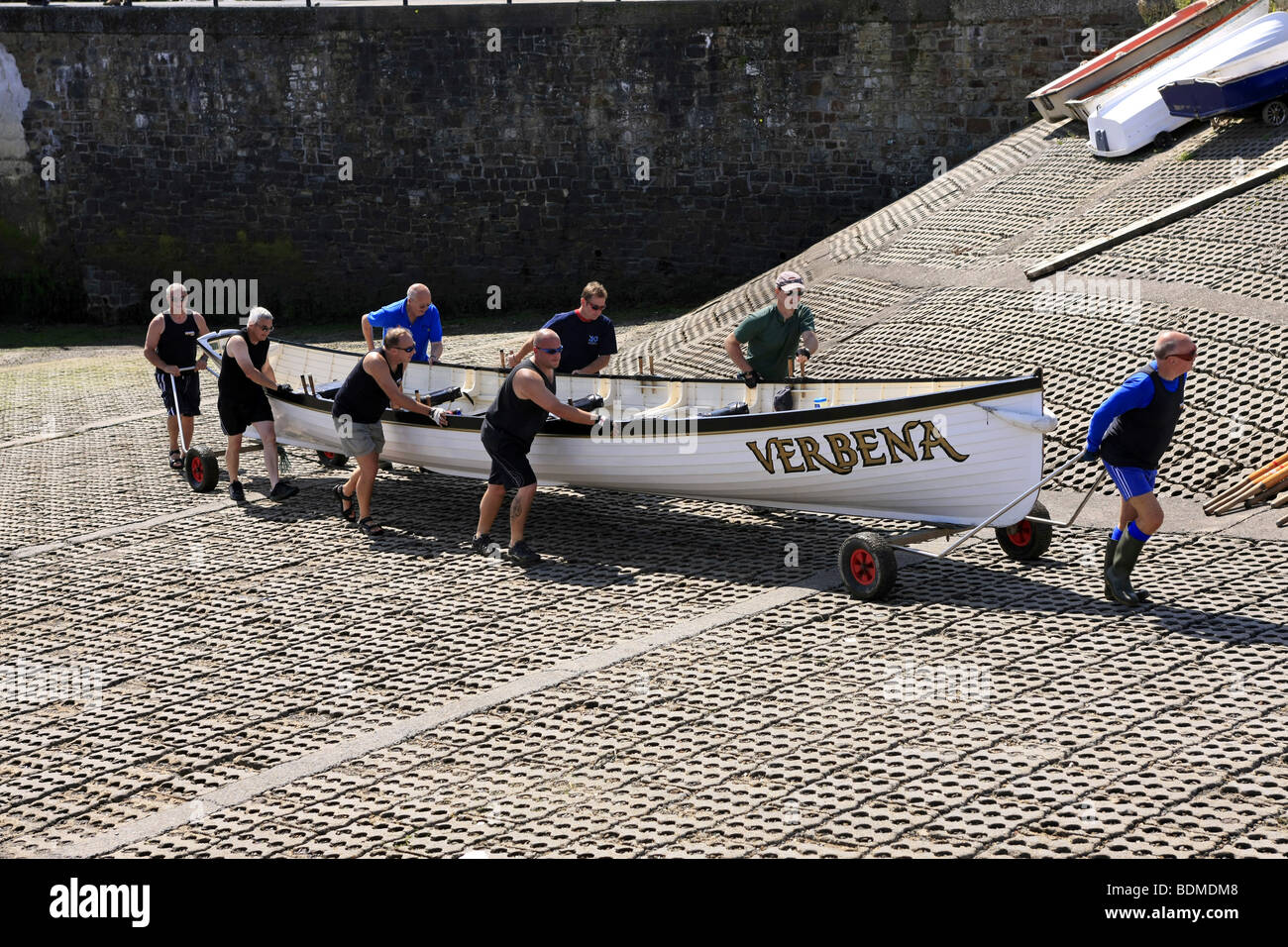 Crewmen of the Gig rowing boat called the Verbena wheel the