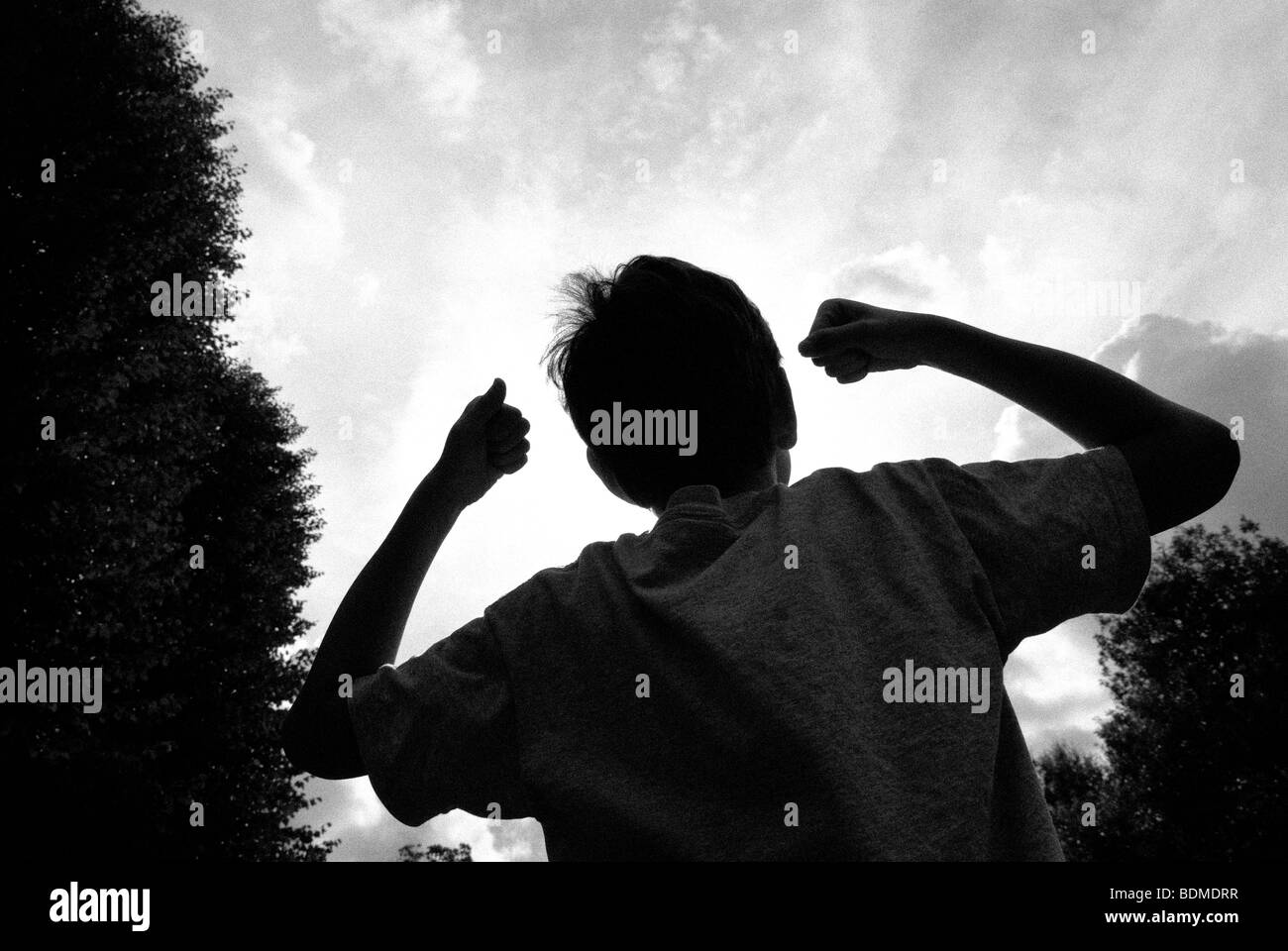 BOY CHEERING - Stock Image