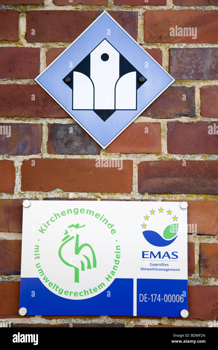 Signs on the church of Jork, Open Door and environmentally friendly actions, Altes Land region, Lower Elbe, Lower - Stock Image