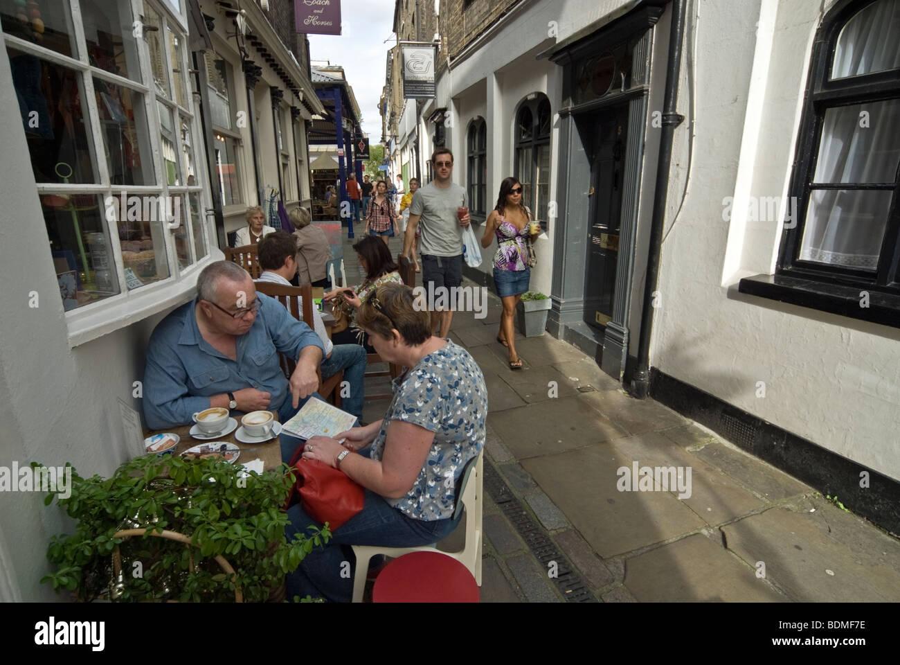 ELDERLY TOURIST COUPLE HAVING LAUNCH IN THE CAFFETERIA GARDEN - Stock Image