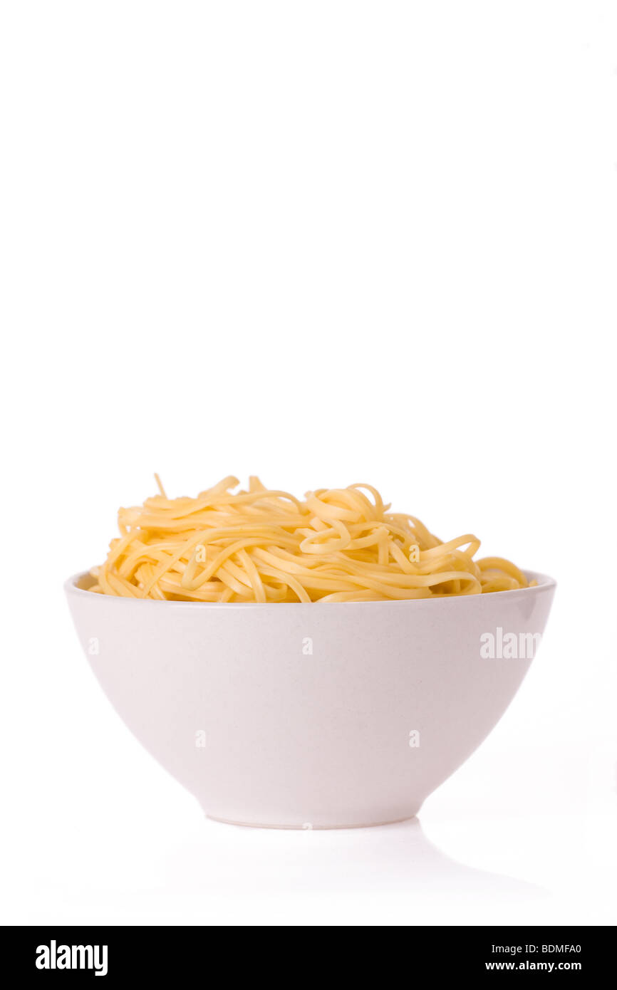 chinese noodles in white bowl - Stock Image