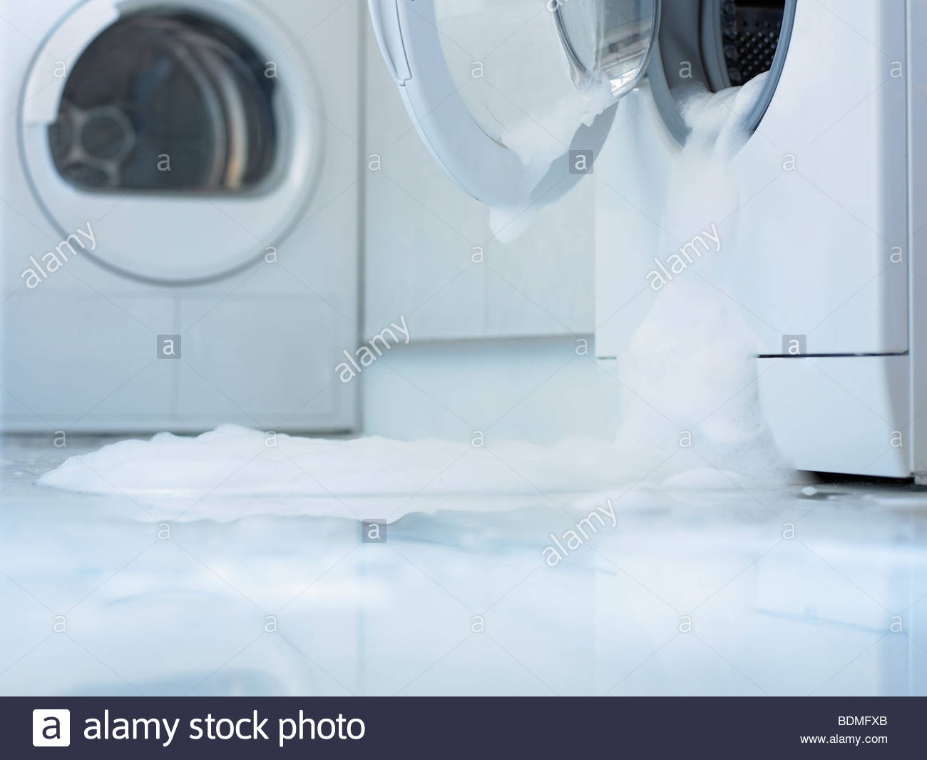 Washing machine overflowing - Stock Image