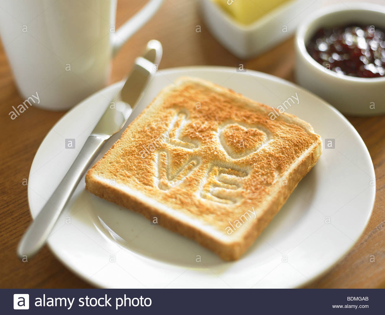 Toast with the word LOVE cooked into surface - Stock Image