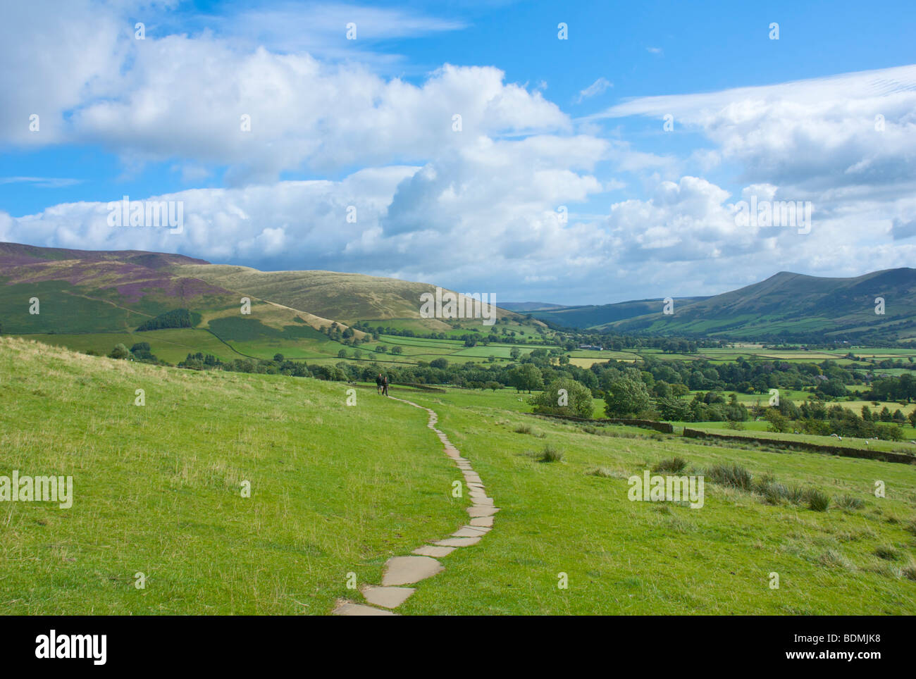 Two walkers on paved Pennine Way between Edale and Upper Booth, Peak National Park, Derbyshire, England UK - Stock Image