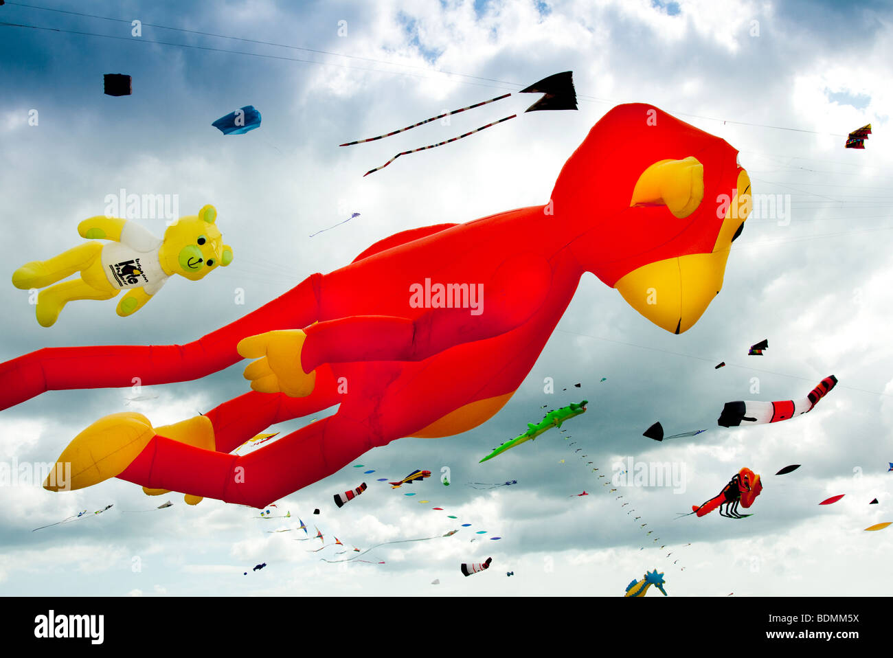 monkey kite flying at a kite festival - Stock Image