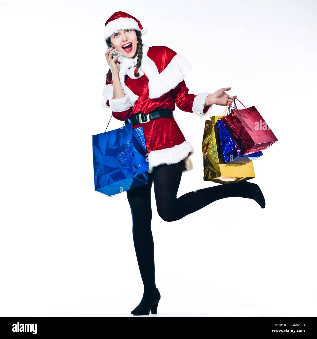 young funny and expressive woman santa claus Christmas Shopping on ...