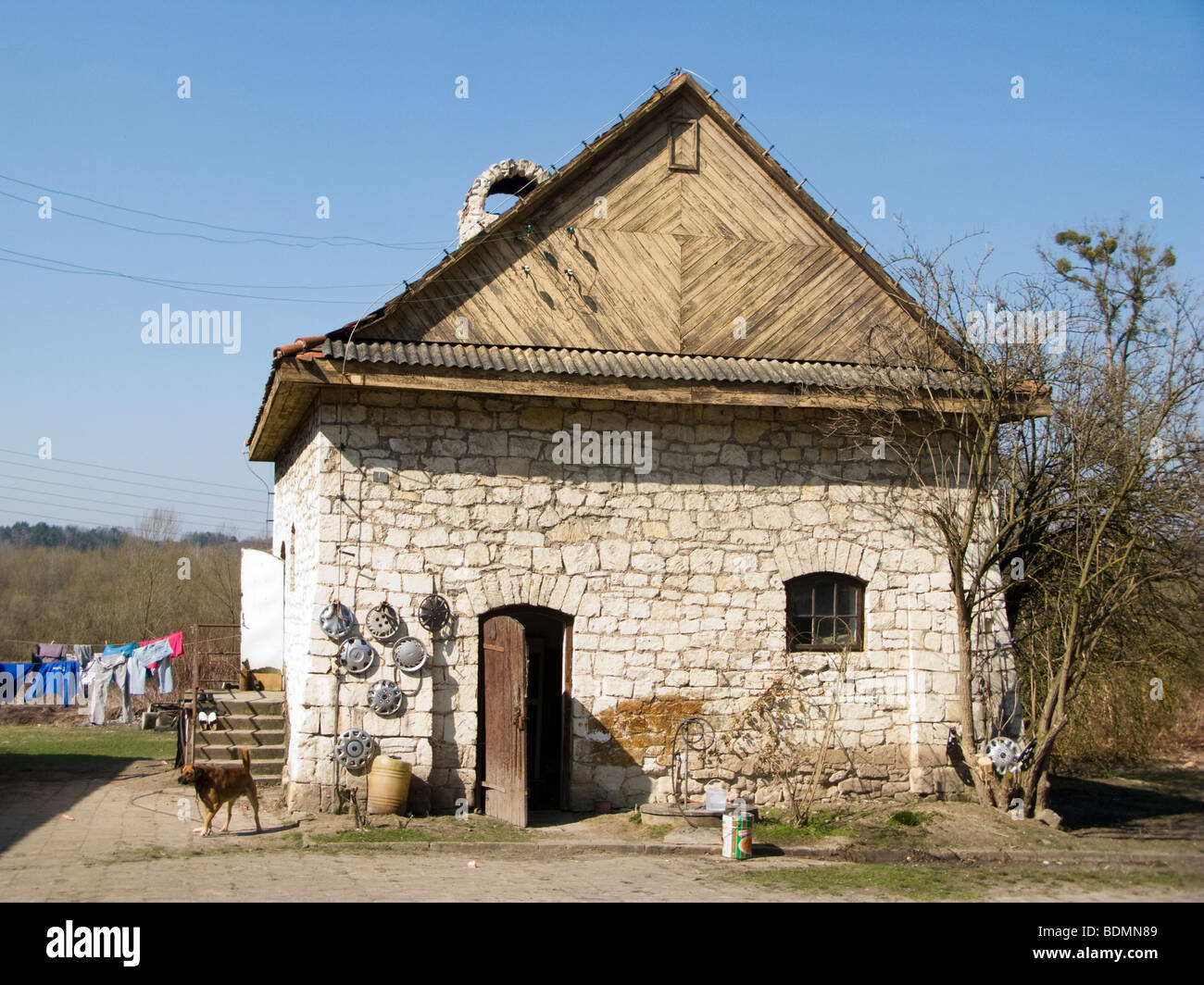 Small farmhouse of brick and wood in a village in eastern Poland - Stock Image