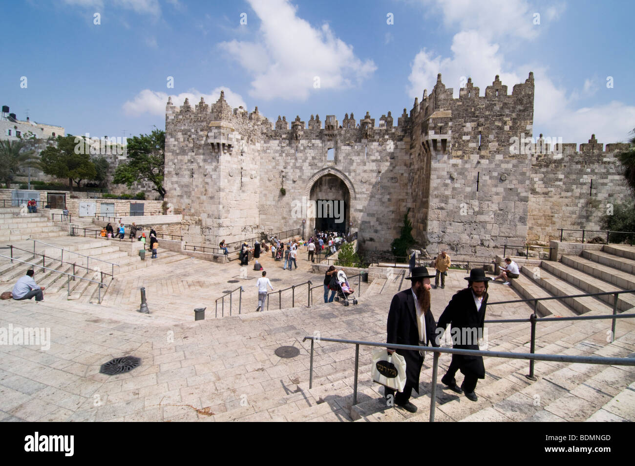 Hasidic Jews on the steps at the Damascus Gate to the Old City of Jerusalem. - Stock Image