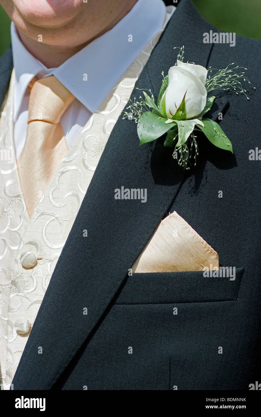 buttonnhole on grooms lapel at wedding Stock Photo