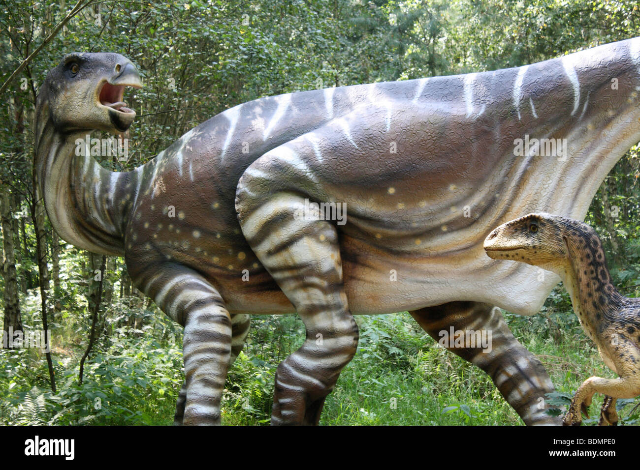 Deinonychus, mother with baby,real size model. 2009 - Stock Image