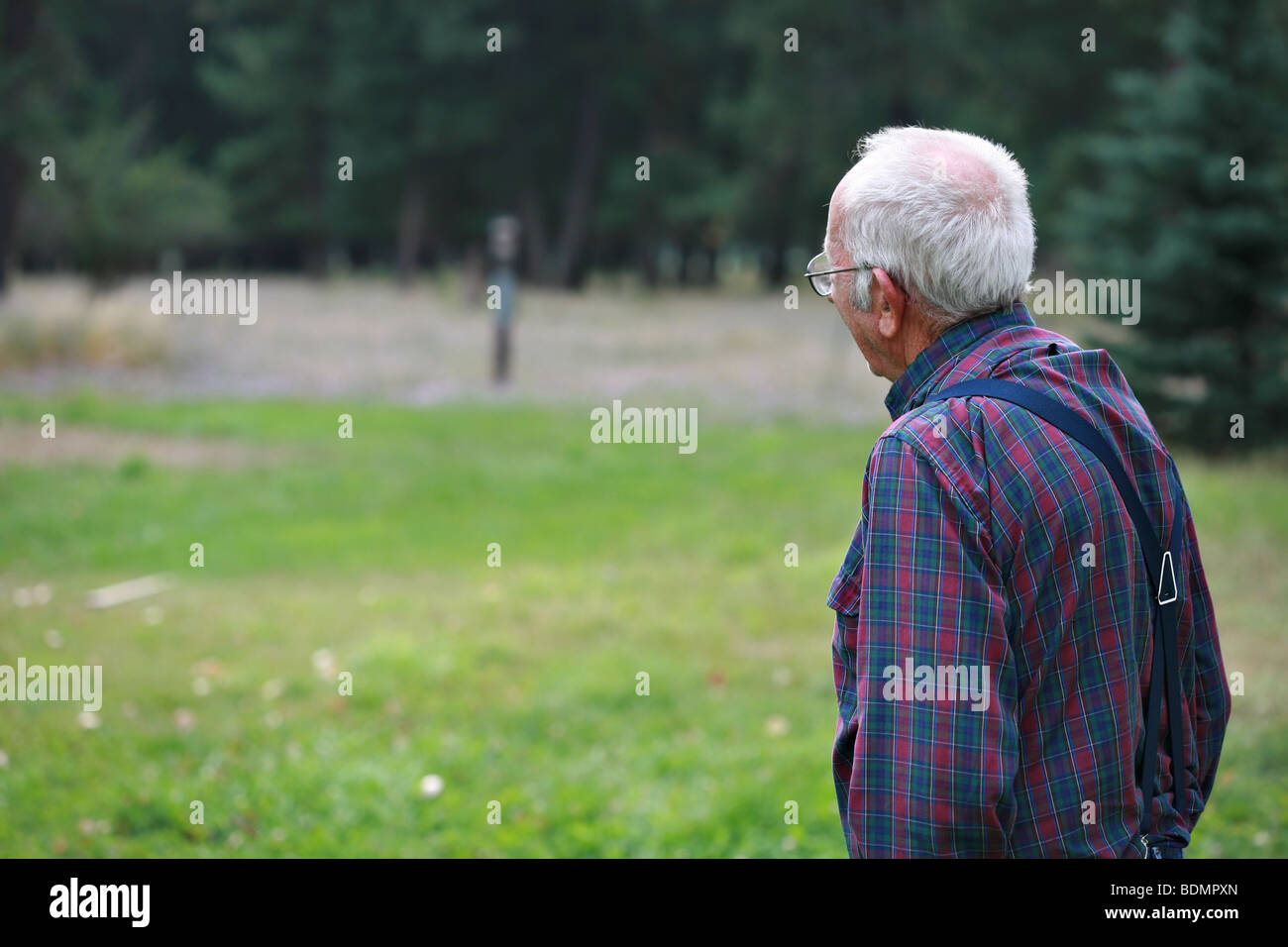 Elderly man looking off, plenty of room for copy space. - Stock Image