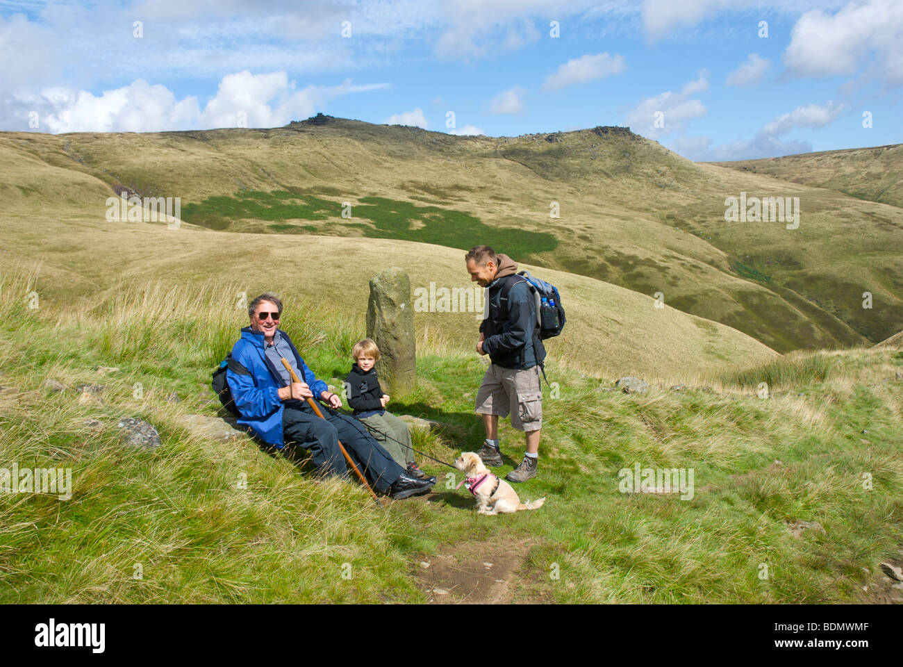 Walkers resting as they climb Jacob's Ladder up to Kinder Scout, near Edale, Peak National Park, Derbyshire, - Stock Image