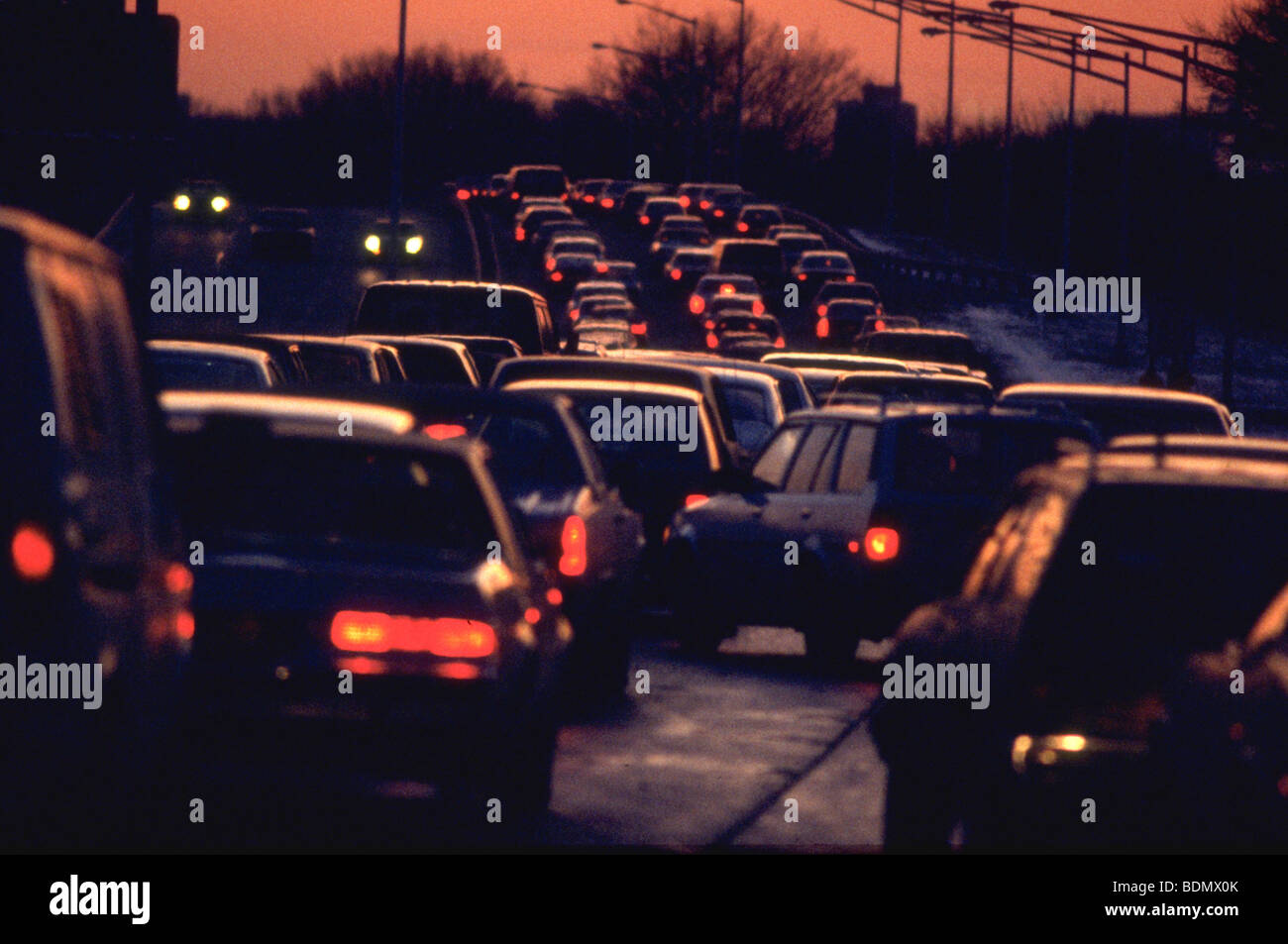 Rush hour traffic at sunset on the Brooklyn-Queens Expressway, near JFK international airport - Stock Image