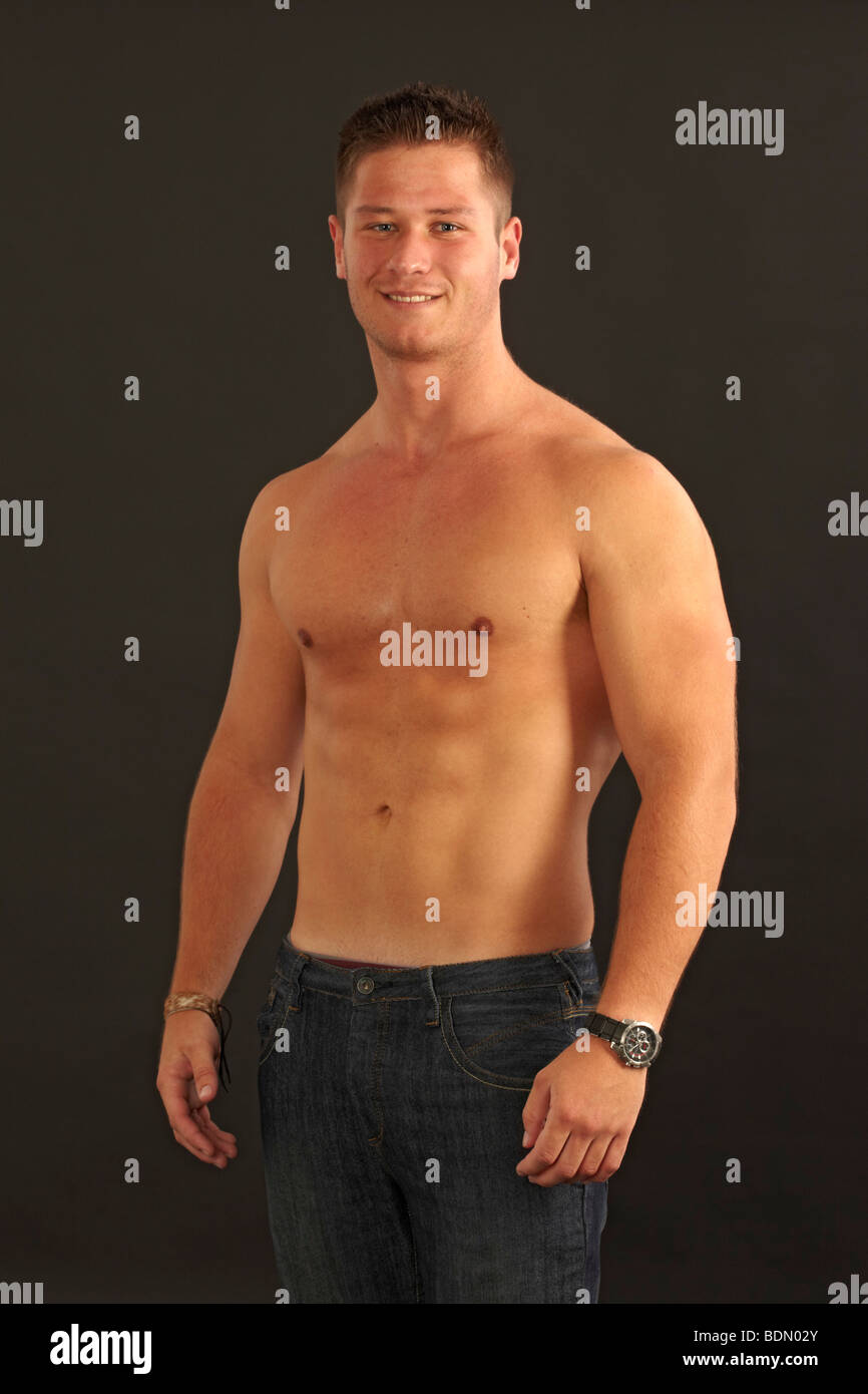 20 year old man without shirt. - Stock Image
