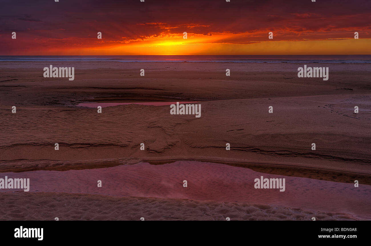A clearing winter storm provides a beautiful dusk sky at Pismo State Beach, Pismo Beach, California, USA. - Stock Image