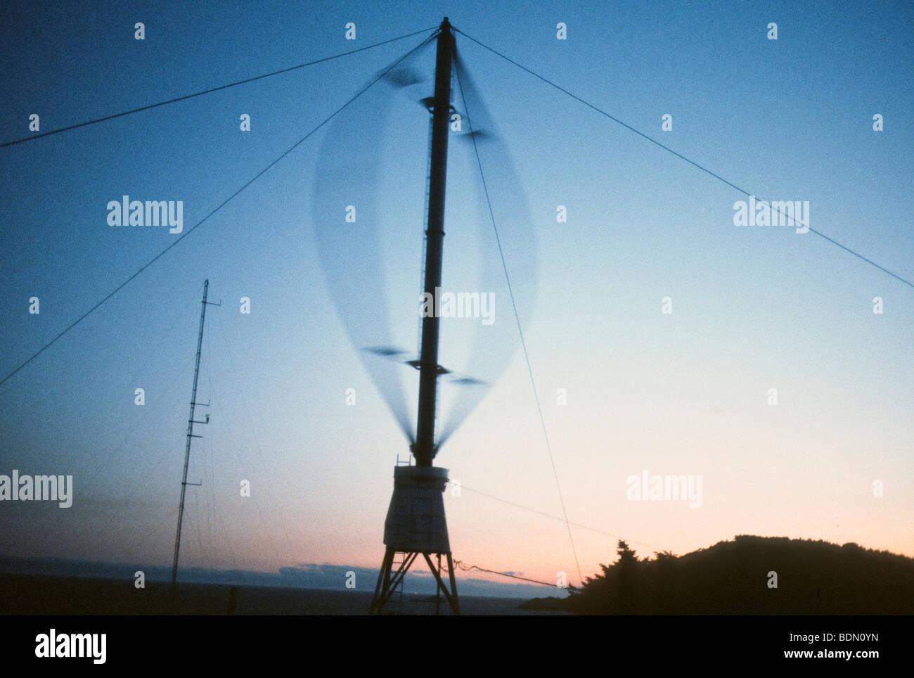 Wind Turbine, Wind mill eggbeater shape in British Columbia, Canada at sunset - Stock Image