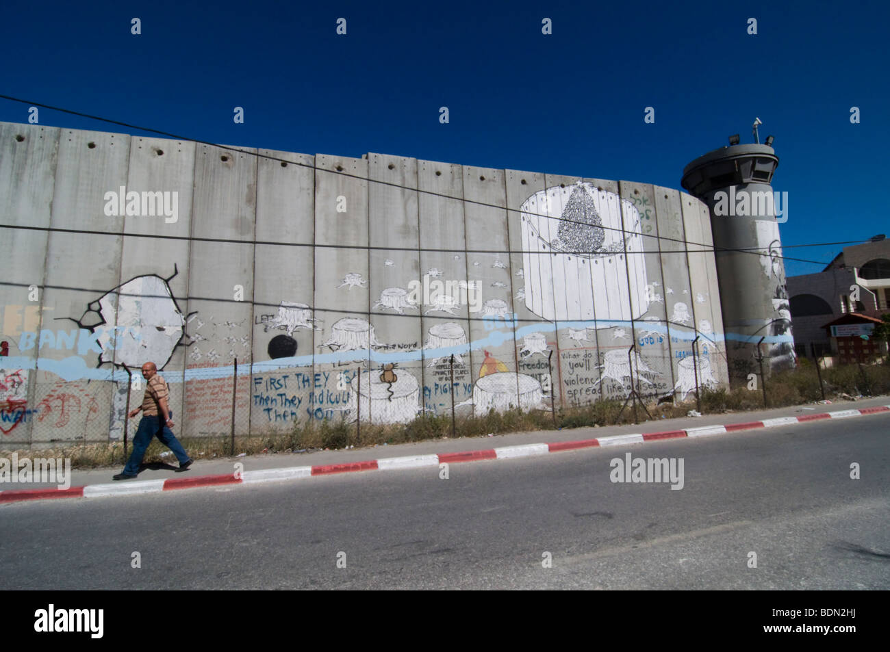 The Israeli separation wall juts into the Palestinian West Bank town of Bethlehem. - Stock Image