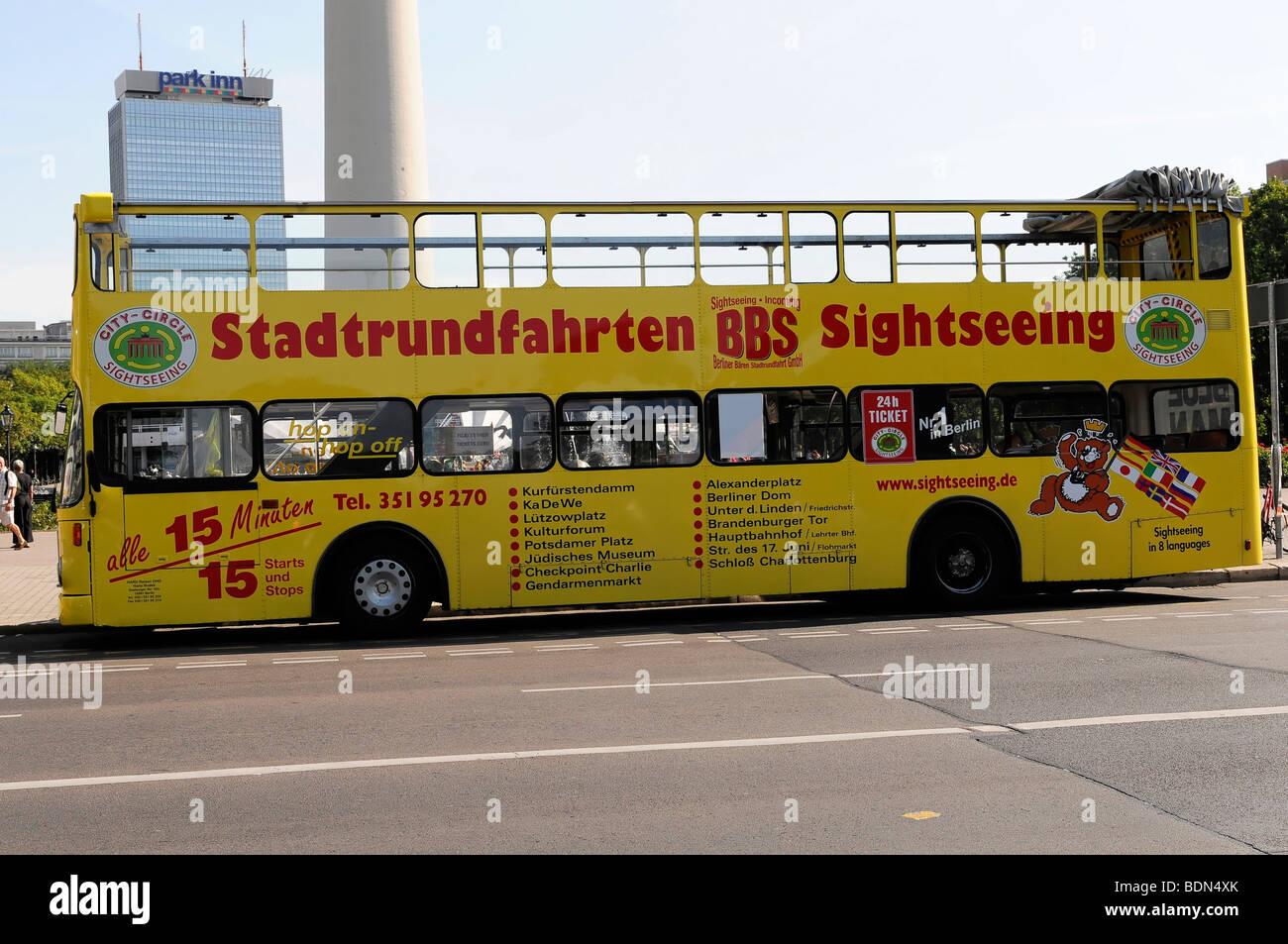 Sightseeing bus driving near the Fernsehturm TV tower, capital Berlin, Germany, Europe - Stock Image
