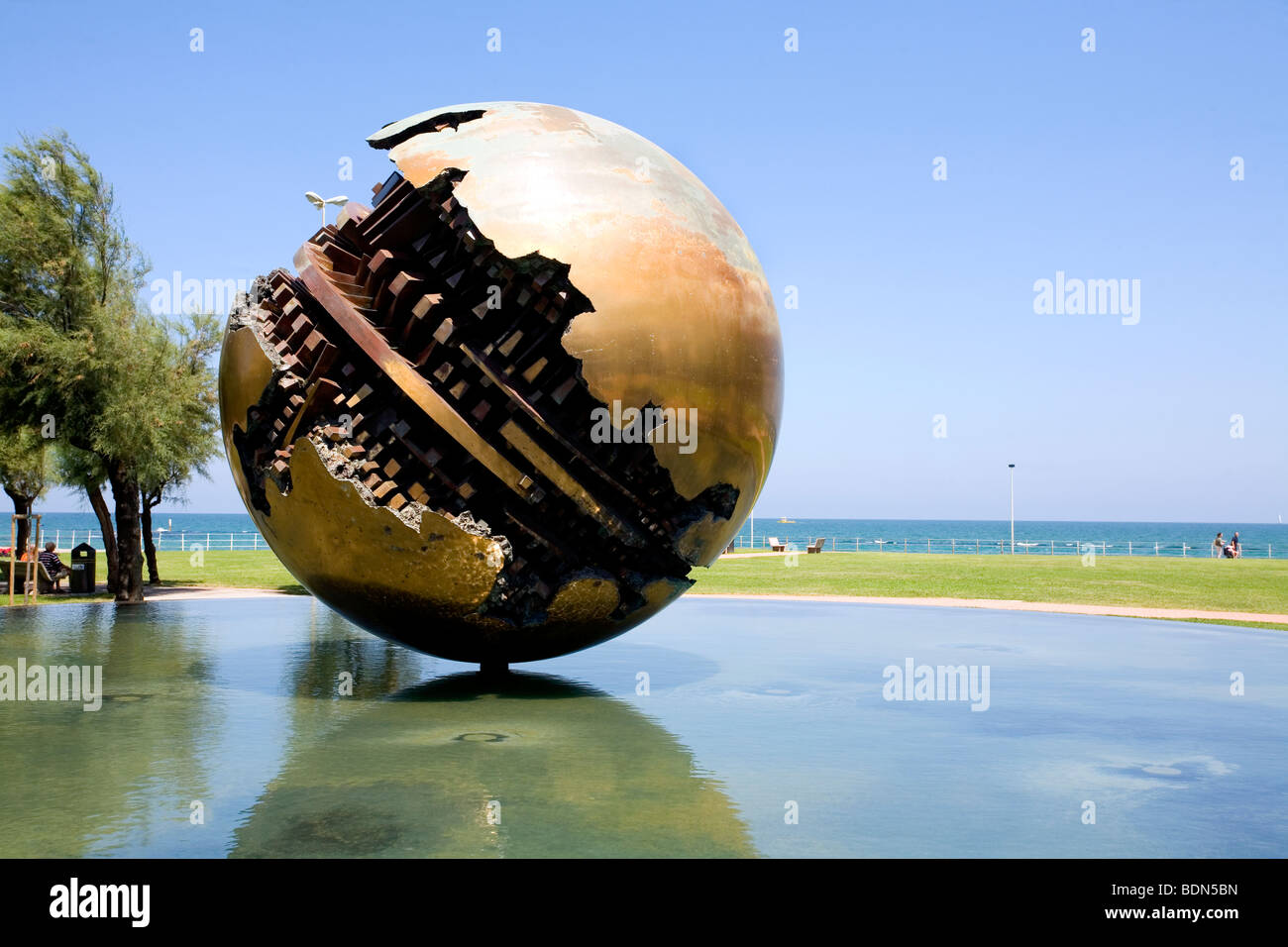 A Sculpture of a Sphere representing the World by Arnaldo Pomodoro in a fountain at the Piazzale della Liberta in - Stock Image