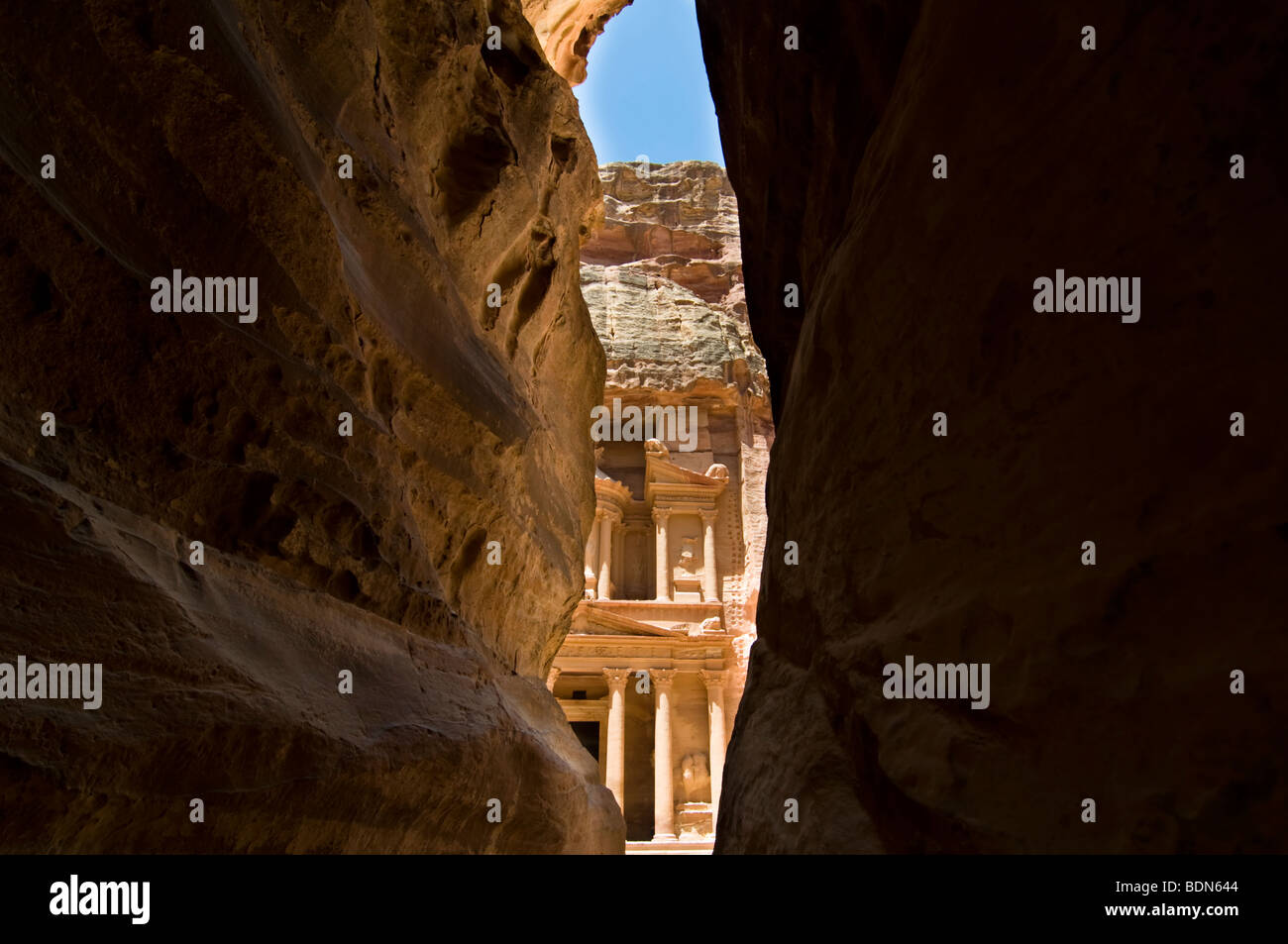 The Treasury seen through the Siq at Petra. - Stock Image