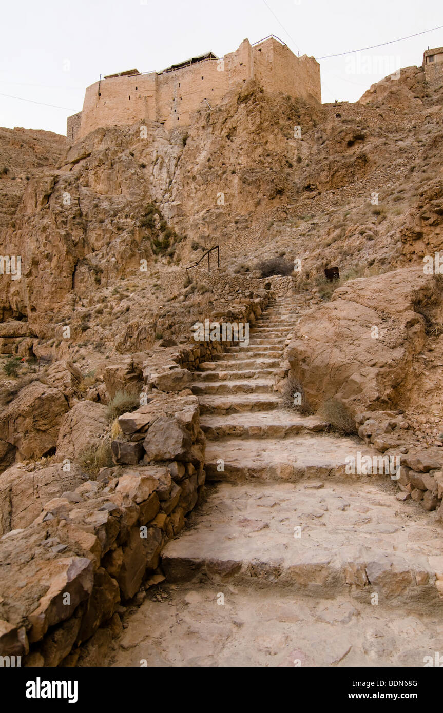 Thousands of stairs climb the desert mountains to reach the Mar Musa (Saint Moses), monastery in Syria. - Stock Image