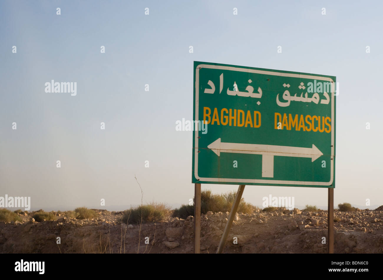 Road signs along a Syrian highway point the way to Baghdad, Iraq and the Syrian capital of Damascus. - Stock Image