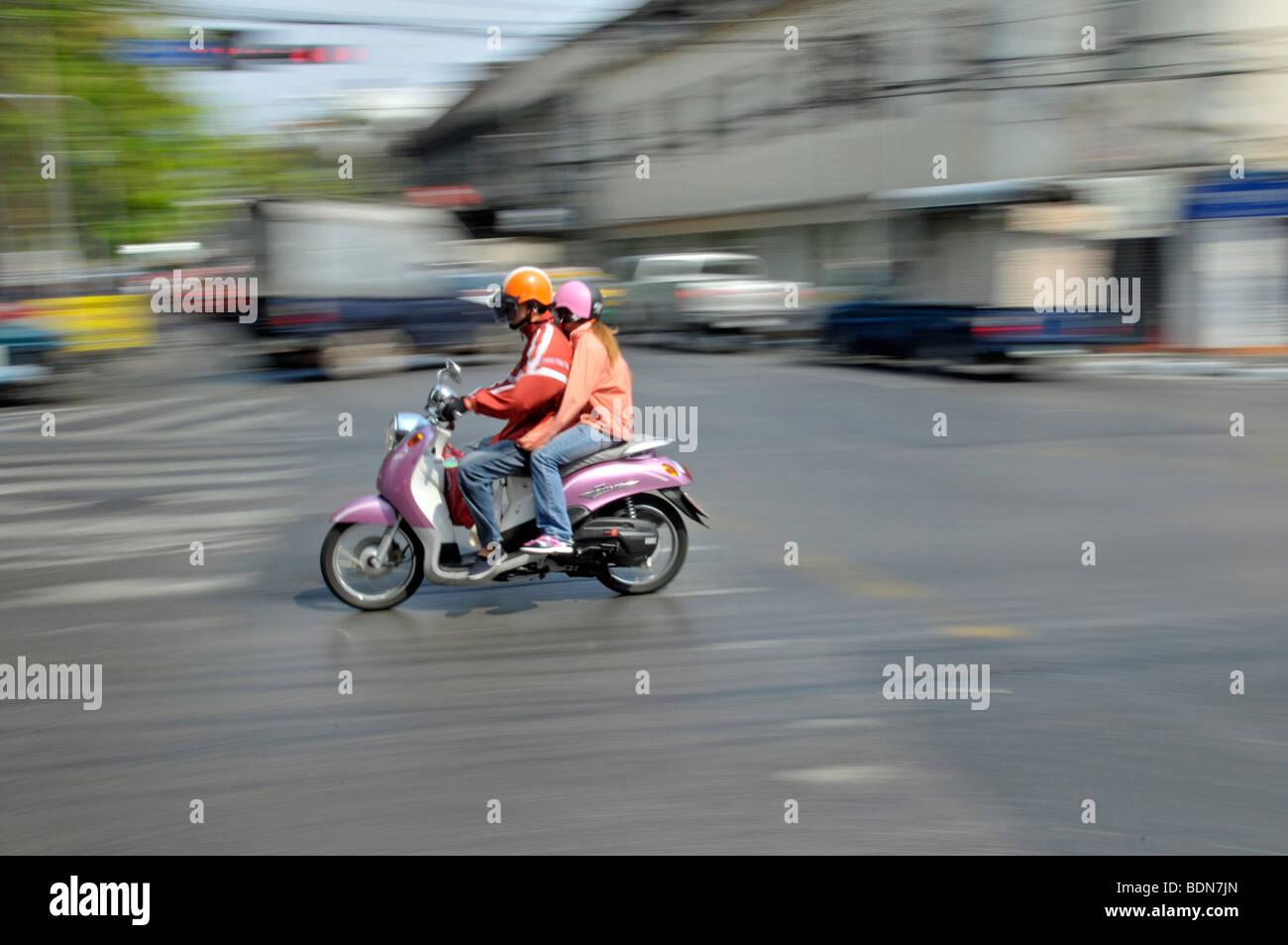 Moped with pillion passenger in traffic chaos, Ratchamnoen Klang Road, Bangkok, Thailand, Asia - Stock Image