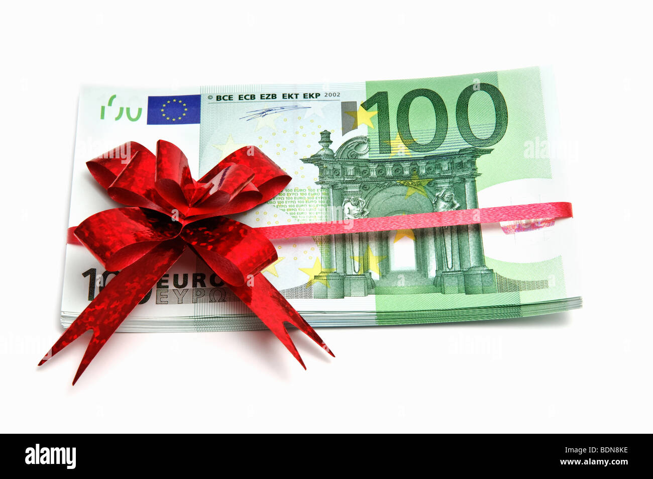 Euro banknotes tied red ribbon on white - Stock Image