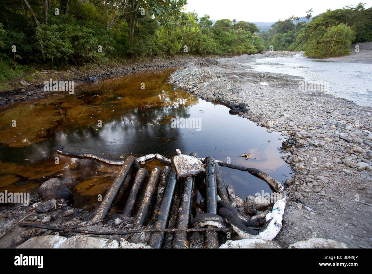 Oil trap at the edge of an Amazonian river, built to retain crude oil from a spill - Stock Image