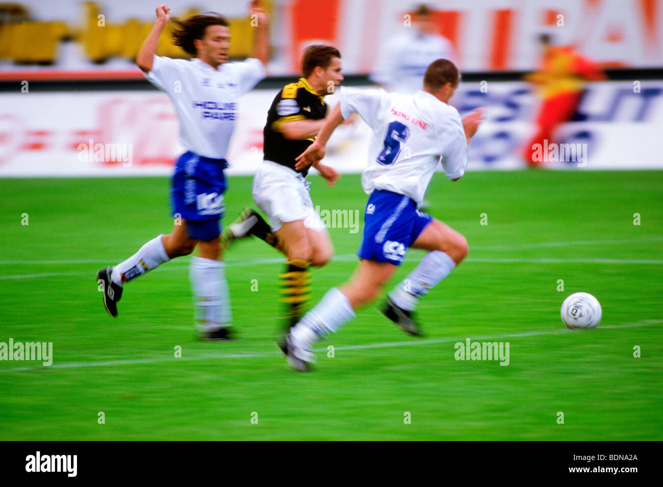 Professional soccer league teams playing game in Rosunda Stadium in Stockholm, Sweden - Stock Image