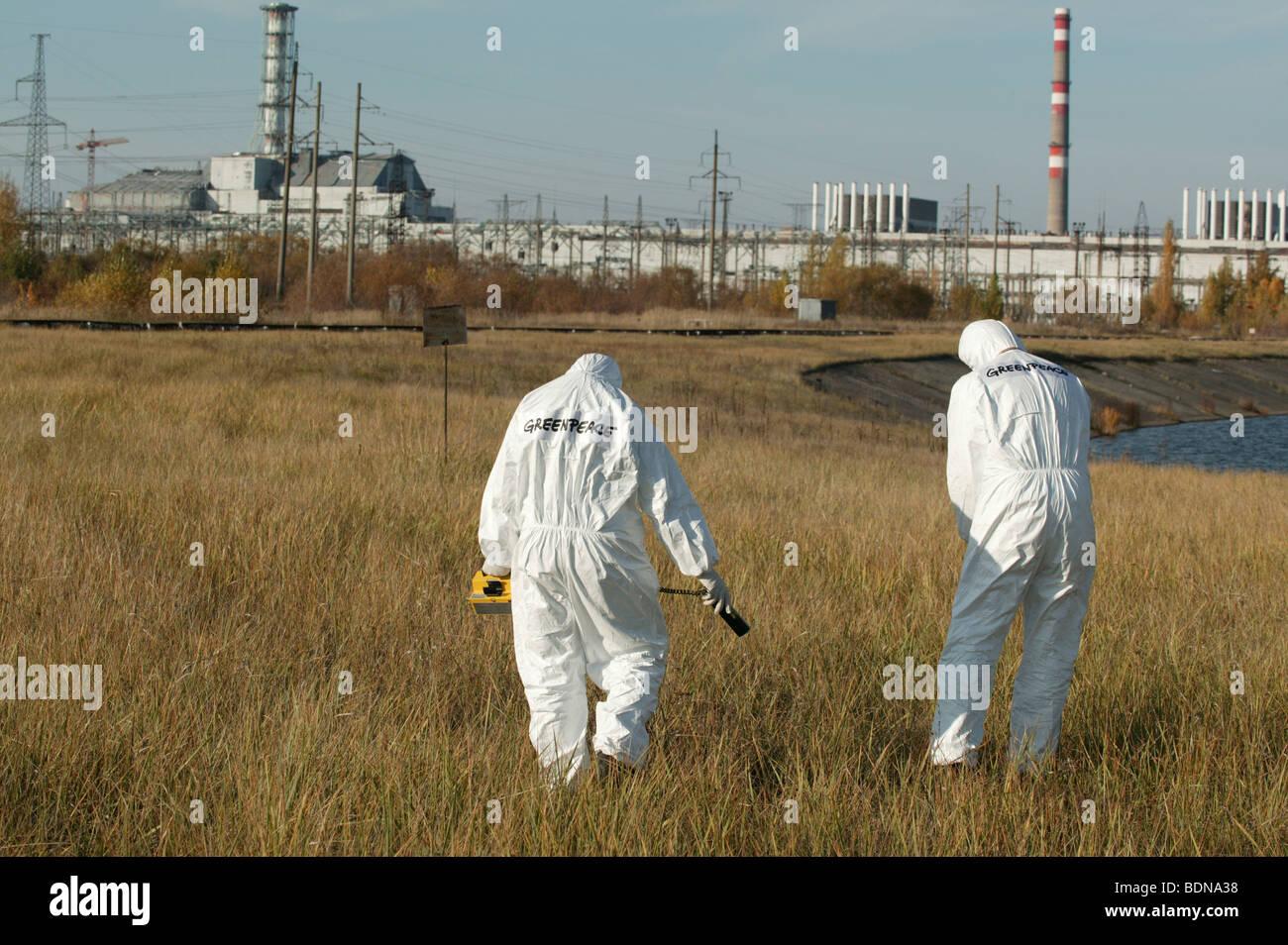 On the ground action training for Greenpeace Radiation Safety Advisors. Measuring radiation levels. - Stock Image