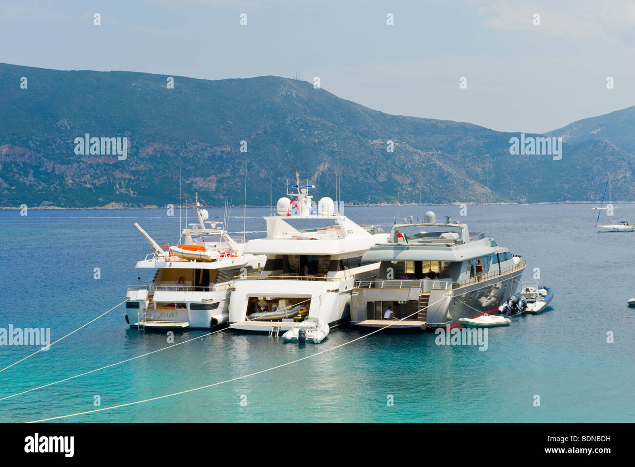 Luxury yachts moored in picturesque harbour at Fiskardo on the Greek Mediterranean island of Kefalonia Greece GR - Stock Image