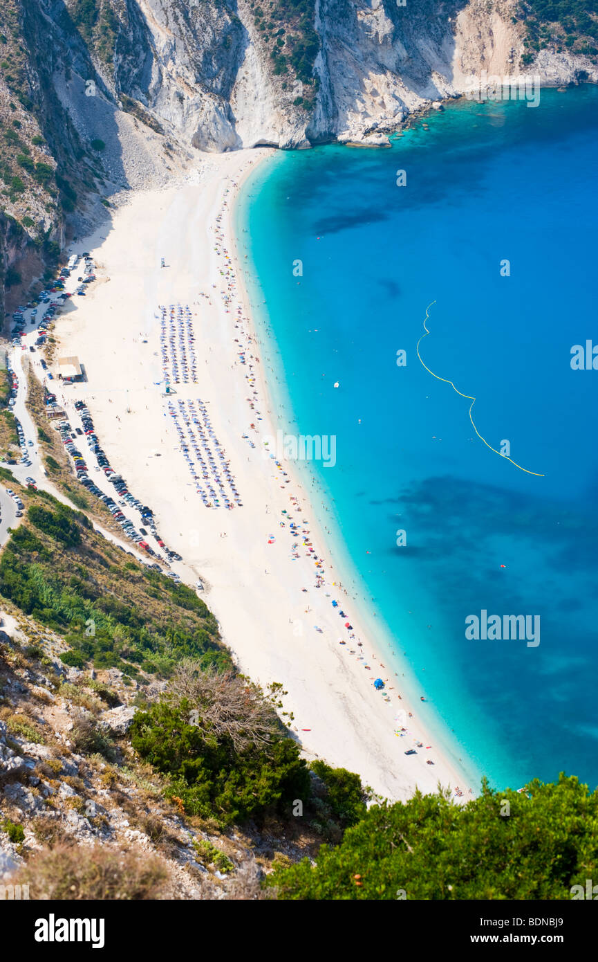 View over picturesque iconic white pebble Myrtos blue flag beach on the Greek Mediterranean island of Kefalonia - Stock Image