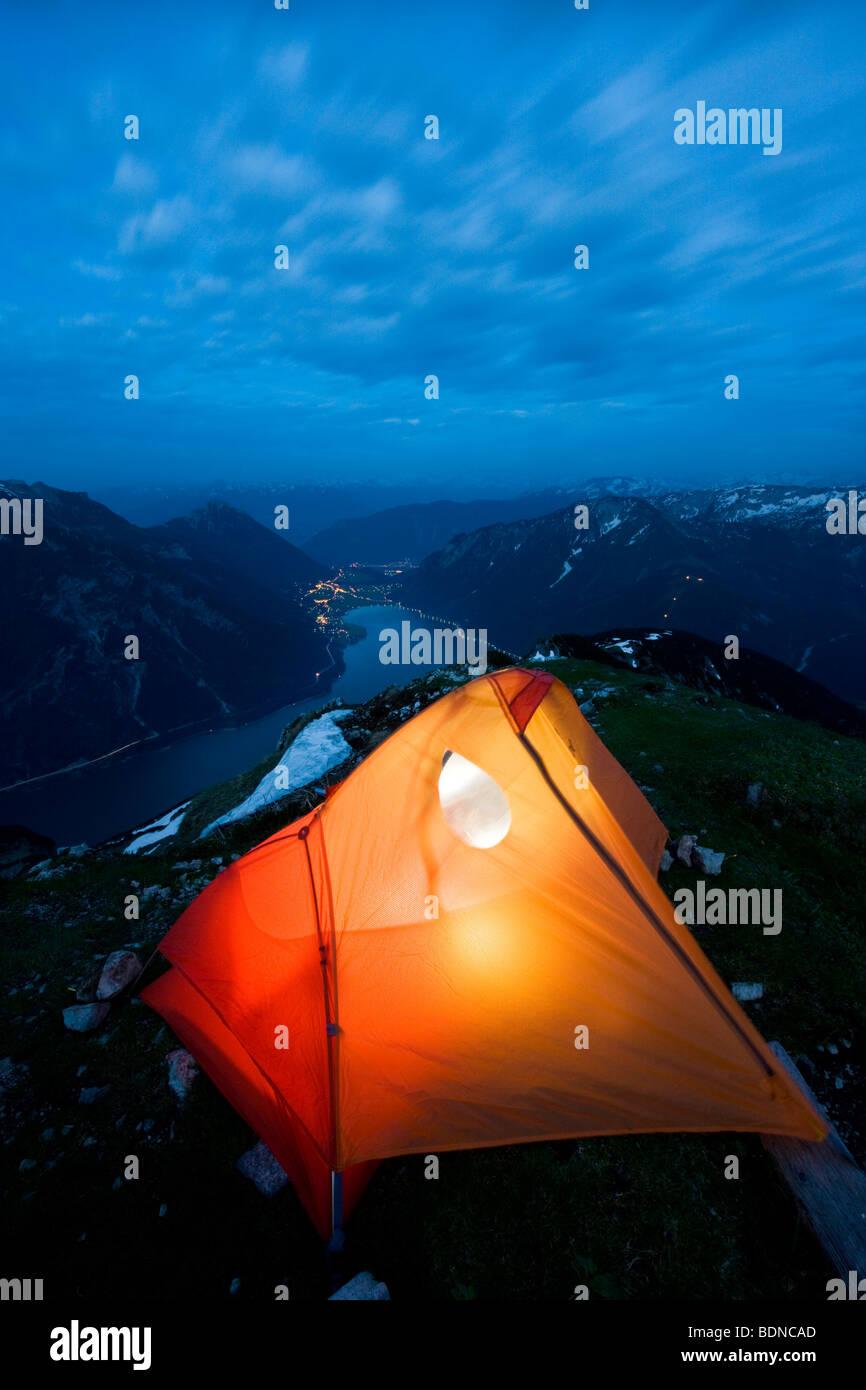 Illuminated tent at Mt. Seebergspitze, Karwendelgebirge mountains, North Tyrol, Tyrol, Austria, Europe - Stock Image