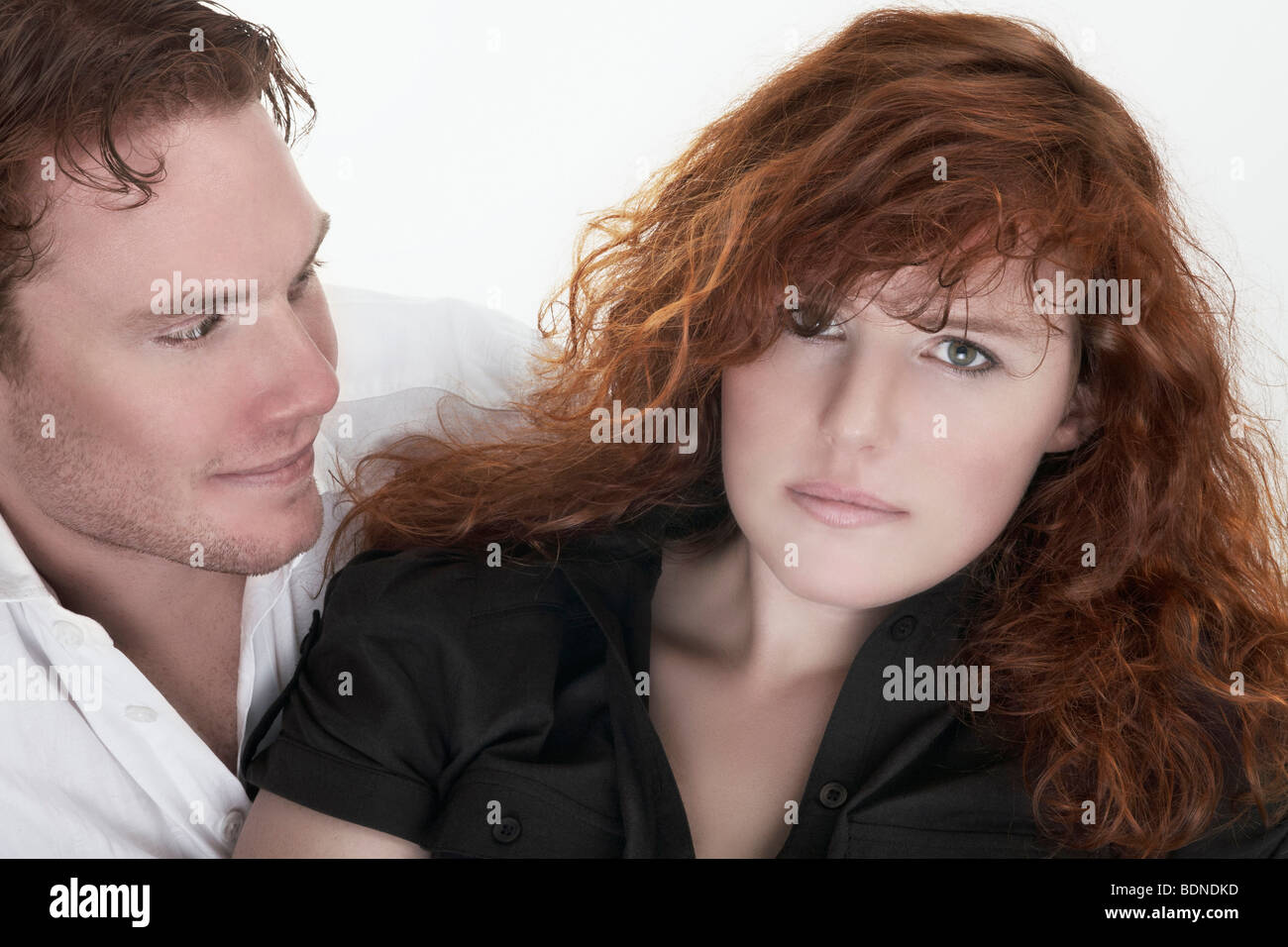 Portrait of a young woman and a young man, couple - Stock Image