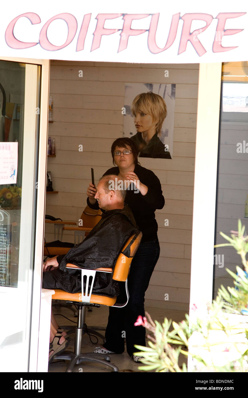 A Man Gets A Hair Cut In A Backstreet Barbers In Le Bois Plage On