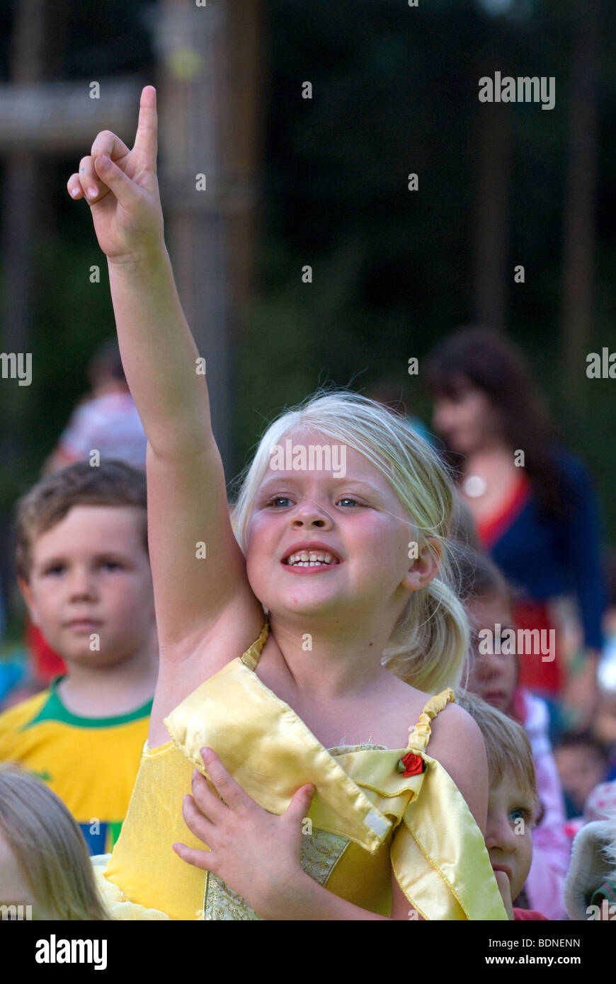 Young girl in animated pose during outdoor production of classic fairytale Cinderella at Alice Holt Park, Farnham, - Stock Image