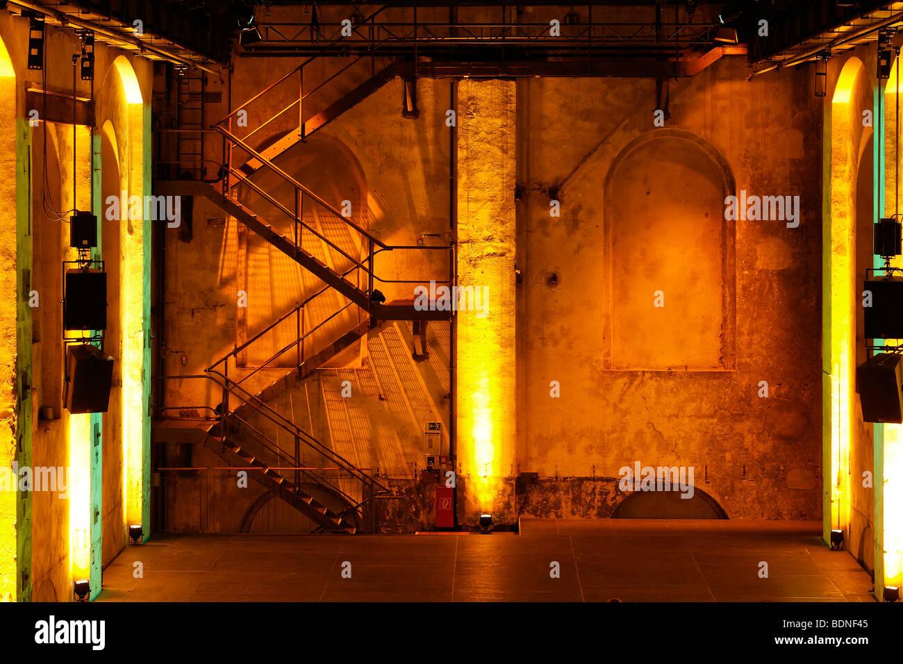 Concert hall in the former Geblaesehallen blower plant, illuminated, Landschaftspark landscape park Duisburg-Nord, - Stock Image