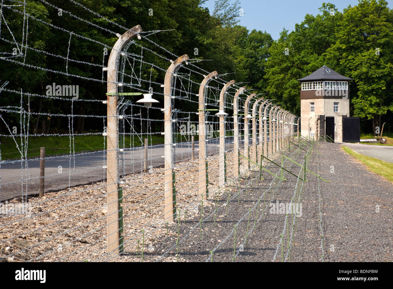 Barbed wire fence and guard tower at the Buchenwald Nazi Concentration Camp, Ettersberg, Germany, Europe - Stock Image