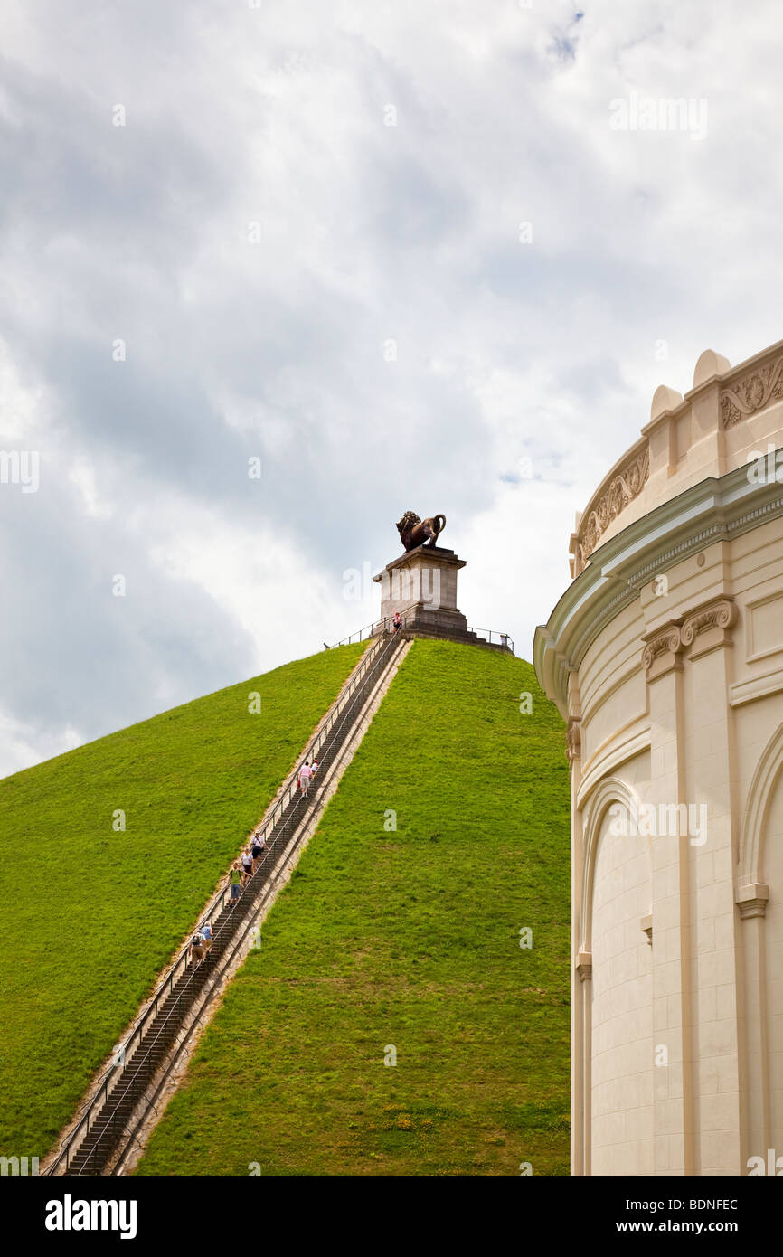Tourists climbing the steps of the Lions Mound memorial to the Battle of Waterloo at Waterloo Belgium Europe - Stock Image