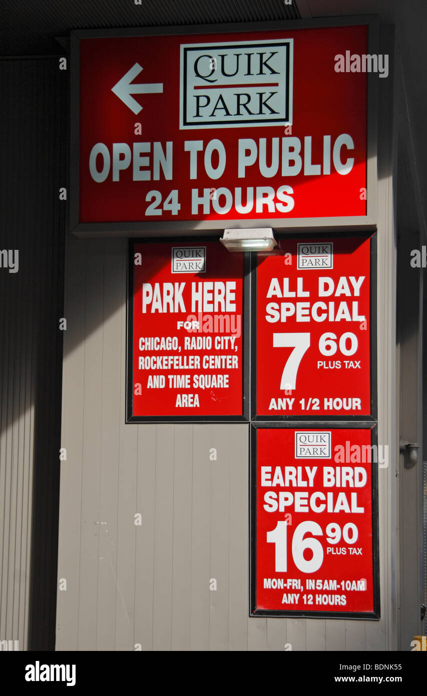Carious price signs at the entrance to the Quik Park car park in New York City, United States. - Stock Image