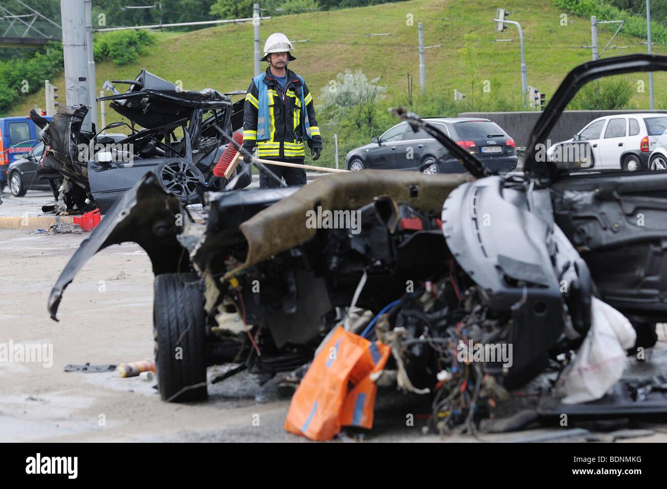 Devastated wreck of a VW Golf on the Koenig-Karls-Bruecke bridge, Stuttgart, Baden-Wuerttemberg, Germany, Europe - Stock Image